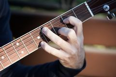 Kate_Volovikova. Guitar fingerboard fingers Royalty Free Stock Photography
