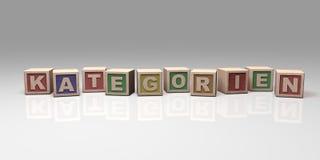 KATEGORIEN escrito com blocos de madeira Imagens de Stock Royalty Free
