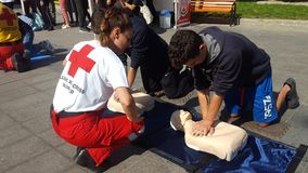 KATERINI, GREECE - OCTOBER 17 2018: The instructor of Red Cross showing CPR on training doll stock images