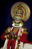 Kathakali artish in gren face paint. Kathakali artist showing hand jesters . face painting is in green and red Royalty Free Stock Photos