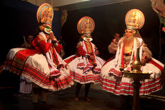 Kathakali artists perform on stage Stock Photos