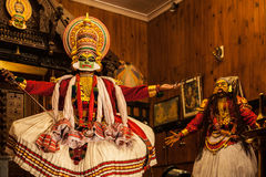 Kathakali performer applying face make-up Stock Photo