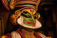 Kathakali performer applying face make-up Stock Images