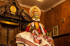 Kathakali performer applying face make-up Royalty Free Stock Photos