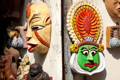 Kathakali and tribal masks in Kochi. Tribal mask and Kathakali dancer face in Mattancherry Market in Kochi, Kerala, India Stock Photography