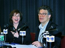 Katherine Lanpher and Al Franken. Katherine Lanpher chuckles at a droll remark by co-host, comedian Al Franken during a broadcast of `The Al Franken Show,` on ` Stock Photos