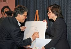 Katherine Lanpher and Al Franken. Katherine Lanpher watches as co-host, comedian Al Franken, draws free-hand a detailed state demarcated map of the United during Stock Image