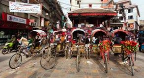 Kathmandu City, rikshas. KATHMANDU, NEPAL, 13TH OF DECEMBER 2013 - Kathmandu City, rikshas and dangerous power line, riksha or rickshaw are one of the best type Royalty Free Stock Photo
