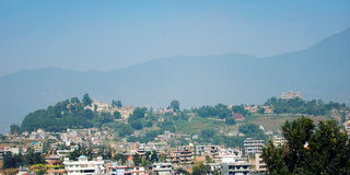 Kathmandu city view - vintage effect. Temples monasteries and mountains in the background. Royalty Free Stock Images