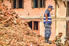 KATHMANDU, NEPAL - APRIL 26, 2015: Debris of buildings at the Durbar square in Kathmandu after, after a 7.8 earthquake, Nepal. Architecture broken building city Royalty Free Stock Photo
