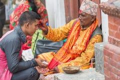 Hindu Pople Receiving Raksha Bandhan at Pashupatinath Temple in stock image