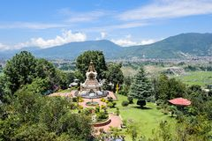 KATHMANDU, NEPAL - AUGUST 27, 2011: A wide view of fountain and garden of Kopan Monastery.Kopan Monastery had its beginnings in th Stock Image
