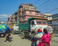 KATHMANDU, NEPAL - 11/13/2017: Busy street traffic. With motorcycles and decorated trucks on a dirt road royalty free stock photography