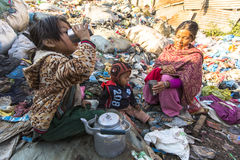 KATHMANDU, NEPAL - child and his parents during lunch in break between working on dump. Stock Images