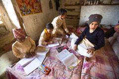 KATHMANDU, NEPAL -  children doing homework at Jagadguru School. Royalty Free Stock Image