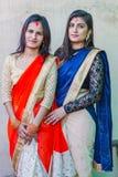 Beautiful Nepali Teen Girls in Colorful Sarees stock photo