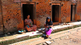 KATHMANDU, NEPAL - JUNE 2013: local women knitting at street Royalty Free Stock Photo