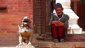 KATHMANDU, NEPAL - JUNE 2013: nepalese man with traditional clothes
