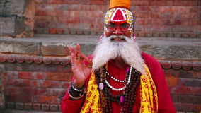 KATHMANDU, NEPAL - JUNE 2013: Sadhu People, traditional Hindu outfit stock footage
