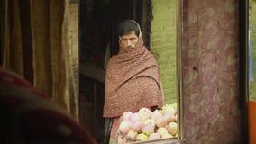 KATHMANDU, NEPAL - MARCH, 2018: Hindu man sells apples on the street, march, 2018. KATHMANDU, NEPAL - MARCH, 2018: Hindu man sells apples on the street, march stock video