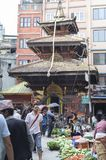 KATHMANDU, NEPAL - MAY 15, 2014: People are shopping a busy street named Ason Tole in front of the Ganesh Shrine, Indra Chowk, Kat Stock Photo