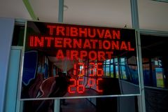 Kathmandu, Nepal, November 02, 2017: Informative sign in red lights over a screen inside of the Tribhuvan International. Airport - Kathmandu, Nepal Royalty Free Stock Photography