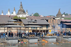 Kathmandu, Nepal, November, 13, 2012, Pashupatinath complex, cremation of dead on the banks of the sacred Bagmati river. Royalty Free Stock Photo