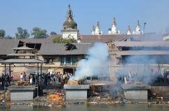 Kathmandu, Nepal, November, 13, 2012, Pashupatinath complex, cremation of dead on the banks of the sacred Bagmati river. Stock Image