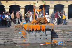Kathmandu, Nepal, November, 13, 2012, Pashupatinath complex, cremation of dead on the banks of the sacred Bagmati river. Royalty Free Stock Photos