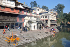Kathmandu, Nepal, November, 13, 2012, Pashupatinath complex, cremation of dead on the banks of the sacred Bagmati river. Stock Images