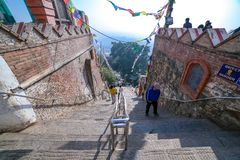 People climbing stairs at Swayambhunath Stupa stock photos
