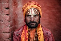 Hindu saint or sadhu posing for a photo stock images
