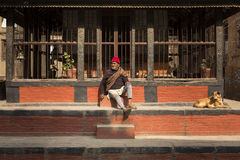 KATHMANDU, NEPAL - NOVEMBER 30: Unidentified man staying with hi Royalty Free Stock Photography