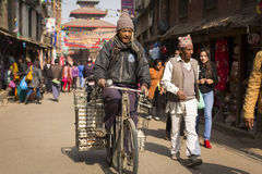 KATHMANDU, NEPAL - NOVEMBER 30: Unidentified man walking on bike Stock Photography