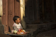 KATHMANDU, NEPAL - NOVEMBER 20: Unknown child on street of the D Royalty Free Stock Photos