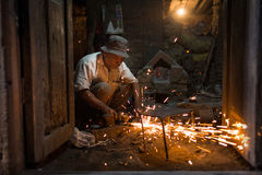 KATHMANDU, NEPAL - NOVEMBER 20: Unknown man working on the Durbar Place on November 20, 2014 Stock Photo