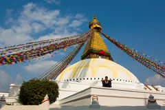 KATHMANDU, NEPAL - NOVEMBER 19 - Unkwon man relaxing on Boudhana Stock Photography
