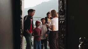 Kathmandu, Nepal - 27 November 2019: A young caucasian girl volunteer talks to Indian Nepali boys of different ages