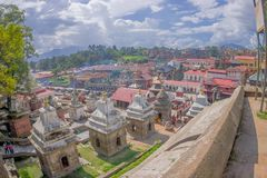 KATHMANDU, NEPAL OCTOBER 15, 2017: Beautiful landscape with some buildings where the Religious burning ritual at. Pashupatina temple happen, in Kthmandu Nepal stock photo