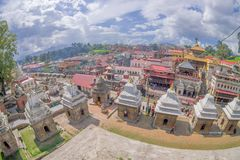 KATHMANDU, NEPAL OCTOBER 15, 2017: Beautiful landscape with some buildings where the Religious burning ritual at. Pashupatina temple happen, in Kthmandu Nepal stock photos
