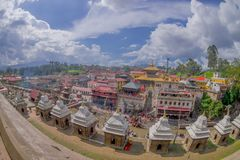 KATHMANDU, NEPAL OCTOBER 15, 2017: Beautiful landscape with some buildings where the Religious burning ritual at. Pashupatina temple happen, in Kthmandu Nepal royalty free stock photo