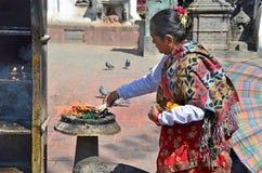 Kathmandu, Nepal, October, 25, 2012, Nepali  Scene: Nepalese woman commits Buddhist ritual in the temple complex Swayambunath Stock Image