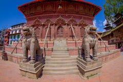 KATHMANDU, NEPAL OCTOBER 15, 2017: North entrance with lion statues, Changu Narayan, Hindu temple, Kathmandu Valley. Nepal royalty free stock photo