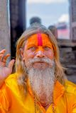 KATHMANDU, NEPAL OCTOBER 15, 2017: Portrait of Shaiva sadhu with white beard, holy man in Pashupatinath Temple with Stock Photos