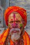 KATHMANDU, NEPAL OCTOBER 15, 2017: Portrait of Shaiva sadhu with white beard, holy man in Pashupatinath Temple with Royalty Free Stock Images