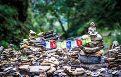 Buddhist Mantra on multicolored flags in himalayas on Annapurna. Kathmandu, Nepal - 06 October 2017: Sanskrit calligraphy of Buddhist Mantra Om Mani Padme Hum on Royalty Free Stock Photos