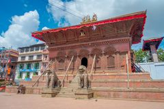 KATHMANDU, NEPAL OCTOBER 15, 2017: Two huge stoned lions at the enter of a temple of Durbar Square near the old Indian Stock Photography