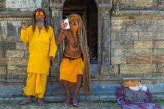 Two Sadhu in Pashupatinath Temple in Kathmandu royalty free stock photos