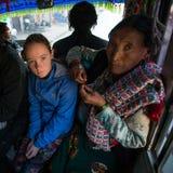 KATHMANDU, NEPAL -  turist teen girl in public transport Kathmandu. KATHMANDU, NEPAL - DEC 23, 2013: Unidentified turist teen girl in public transport Kathmandu Stock Photo