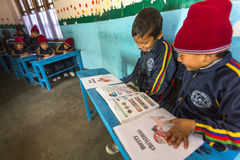 KATHMANDU, NEPAL - Unknown pupils in English class at primary school. Royalty Free Stock Photography